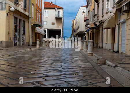 Zadar, Croatia - July 23, 2018: Empty street at sunrise in Zadar old town - Stock Photo