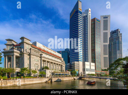 Fullerton Hotel at Singapore River and Financial District Skyscrapers, Central Area, Central Business District, Anderson Bridge, Singapore, Asia, Singapore - Stock Photo
