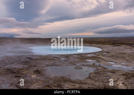 Geyser area in Haukadalur valley, southwestern Iceland - Stock Photo