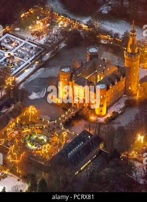 Aerial view, Bedburg-Hau, Lower Rhine, Moyland castle, Christmas market, night photography, blue hour, handcraft Christmas market, North Rhine-Westphalia, Germany, Europe Stock Photo