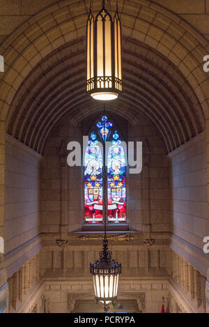 Ottawa, Ontario, Canada.  Stained glass window with Queens Victoria and Elizabeth II above Senate foyer entrance, Centre Block, Parliament Hill. - Stock Photo