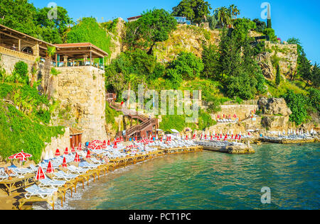 ANTALYA, TURKEY - MAY 11, 2017: Mermerli beach is the popular place in old town, neighboring with marina, public garden and numerous coastal restauran - Stock Photo