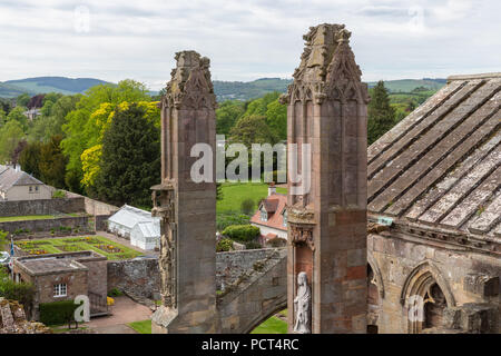 Aerial view from ruins of Scottish Melrose abbey to courtyard - Stock Photo