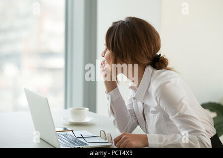 Smiling businesswoman looking far away dreaming about future suc - Stock Photo