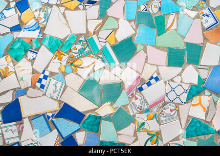 broken pieces of beautiful ceramics tiled in mosaic on street wall in ceramic capital of Italy, Vietri Sul Mare, Campania, Italy - Stock Photo
