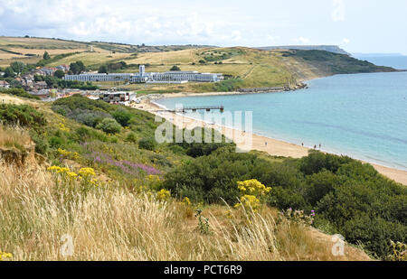 Dorset - Weymouth   - clifftop view across the bay to Riviera Hotel at Bowleaze Cove - high summer - Stock Photo