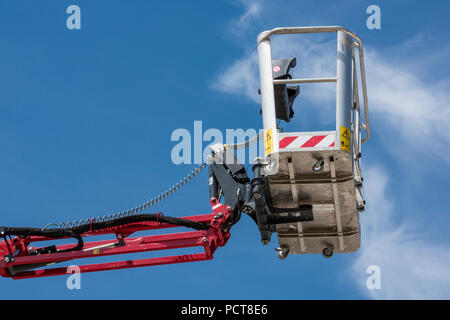 cherry picker or mobile elevated work platform basket or access platform for reaching heights and working at height on building sites and construction - Stock Photo