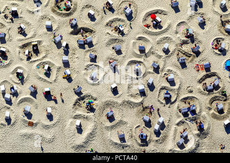 Sandy beach with beach chairs and sand walls, bathers, summer holidays, holidays by the sea, sand castles, aerial photo, Wangerooge, North Sea, North Sea island, East Frisian Islands, Lower Saxony, Germany - Stock Photo