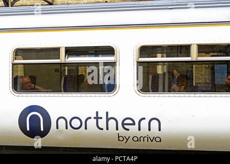 Northern By Arriva logo on train carriage, Warrington Central Station, Cheshire, North West England, UK - Stock Photo