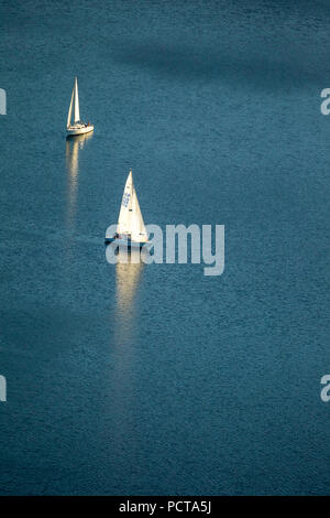 Two sailboats on Lake Hennesee, calm, Meschede, Sauerland, North Rhine-Westphalia, Germany - Stock Photo