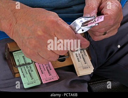 Tram tickets, being punched, Birkenhead Tramways, Merseyside, North West England, UK - Stock Photo
