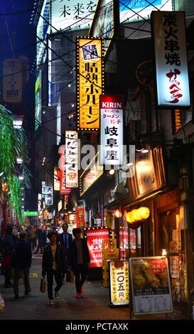 Night life in Tokyo. Small and popular restaurants along Omoide Yokochō lane in Shinjuku District - Stock Photo