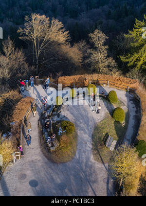 Observation platform on the Uetliberg near Zurich in evening light with walkers - Stock Photo