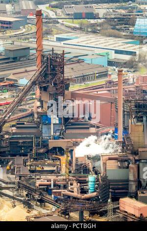 Blast furnace with glowing slag MÖV EV Schwelgern, steel industry, heavy industry, Marxloh, Thyssen Steel in Duisburg, Ruhr area, North Rhine-Westphalia, Germany - Stock Photo