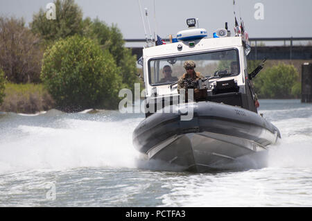 Members of Port Security Unit 309 waterside division underway for a Anti-terrorism, Force Protection Mission Patrol, Guantanamo Bay, Cuba, July 23, 2018. Port Security Unit 309 is deployed for 9 months in support of Operation Freedom's Sentinel. - Stock Photo