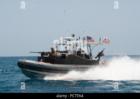 Members of Port Security Unit 309 waterside division underway for a Anti-terrorism, Force Protection Mission Patrol off the coast of Guantanamo Bay, Cuba, July 23, 2018. Port Security Unit 309 is deployed for 9 months in support of Operation Freedom's Sentinel. - Stock Photo