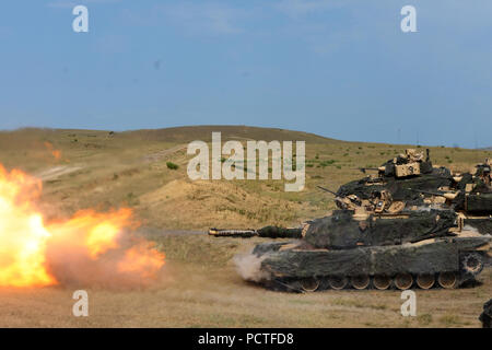 A M1A2 Abrams tank crew assigned to Charlie Company, 2nd Battalion, 5th Cavalry Regiment, 1st Armored Brigade Combat Team, 1st Cavalry Division fires on range 11 at Vaziani Training Area, Georgia, Aug. 2, 2018.  Noble Partner 2018 is a Georgian Armed Forces and U.S. Army Europe cooperatively-led event improving readiness and interoperability of Georgia, U.S. and participating nations. - Stock Photo