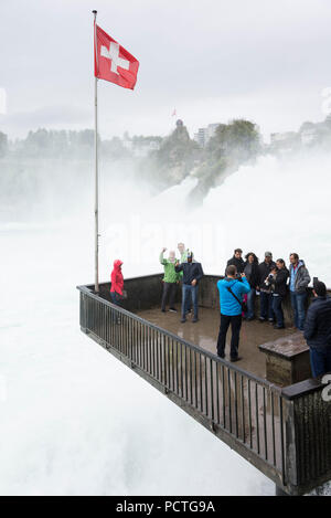 View from observation terrace on Rhine Falls and Rhine Falls rock with view of Neuhausen, canton Schaffhausen, Switzerland - Stock Photo