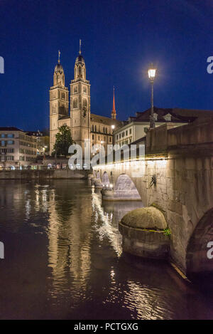 View of Münsterbrücke and Grossmünster at night, old town, Zurich, Canton of Zurich, Switzerland - Stock Photo