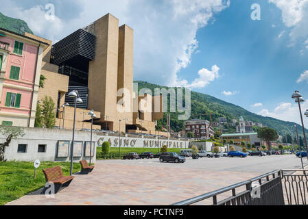 Campione d'Italia, Italy - May 18, 2018: Campione d'Italia on Lake Lugano, famous for its casino, italian town entirely surrounded by the Switzerland - Stock Photo