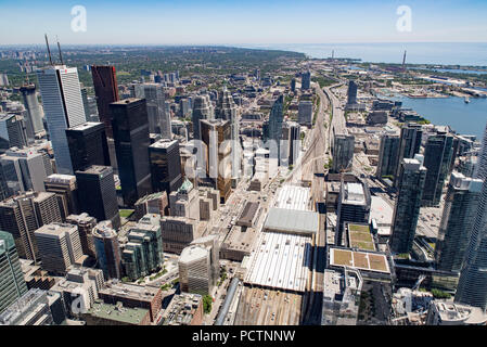 Toronto, Ontario, Canada. Looking east from top of CN Tower toward Scarborough and ports on Lake Ontario in summer; Union Station lower middle. - Stock Photo
