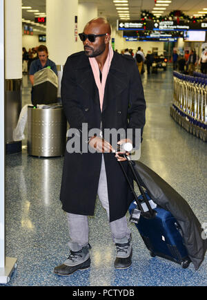 MIAMI, FL - DECEMBER 05: (EXCLUSIVE COVERAGE) Jimmy Jean-Louis at Miami International Airport. Jimmy Jean-Louis is a Haitian actor and model best known for his role as 'the Haitian' on the NBC television series Heroes on December 5, 2015 in Miami, Florida   People:  Jimmy Jean-Louis - Stock Photo