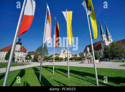 Germany, Bavaria, Upper Bavaria, Altötting, chapel place, Town Hall, Chapel of Mercy, Collegiate Church, Flags - Stock Photo