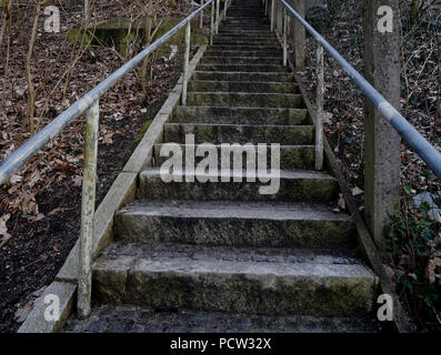 Germany, Bavaria, Upper Bavaria, Neuötting, weathered stone stairs with railing, gloomy - Stock Photo