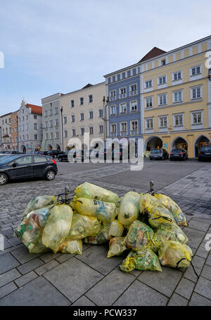 Germany, Bavaria, Upper Bavaria, Neuötting, city square, yellow sacks, waste separation - Stock Photo