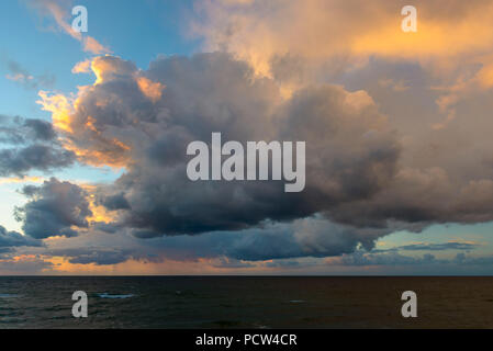 Thunderclouds at sunset over Baltic Sea, Nienhagen, Baltic Sea, Western Pomerania, Mecklenburg-Vorpommern, Germany - Stock Photo