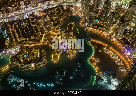 Detail aerial view at night of downtown Dubai and artificial lake, United Arab Emirates. - Stock Photo