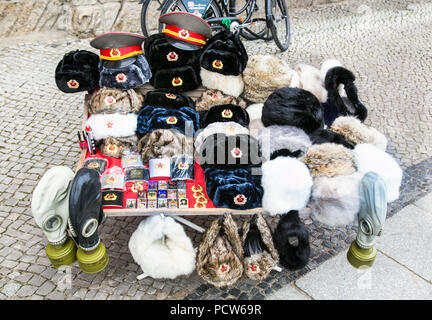 BERLIN, GERMANY- OCT 28, 2016: Sale stand of Soviet and DDR militaria near Checkpoint Charlie in Berlin on Oct 28, 2016. Germany. - Stock Photo