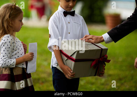 Father giving present to son. Happy smiling Boy receiving a gift. Happy family, Birthday, New year, Christmas concept - Stock Photo