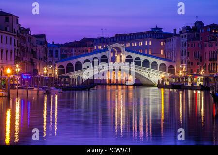 Venice's iconic Rialto Bridge at twilight - Stock Photo