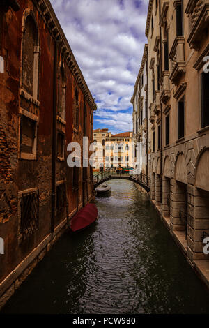 A narrow side canal in Venice, Italy - Stock Photo