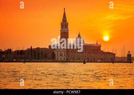 Venice's island of San Giorgio Maggiore under a setting sun - Stock Photo