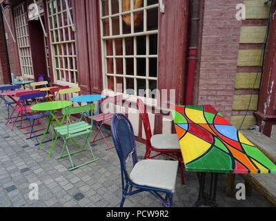 Colorful Tables And Chairs On The Beach On A Sunny Day At