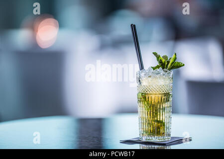 Mojito summer alcoholic cocktail on table in restaurant. - Stock Photo