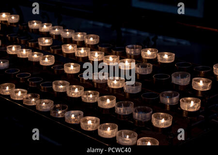 prayer candles in cathedral - Stock Photo