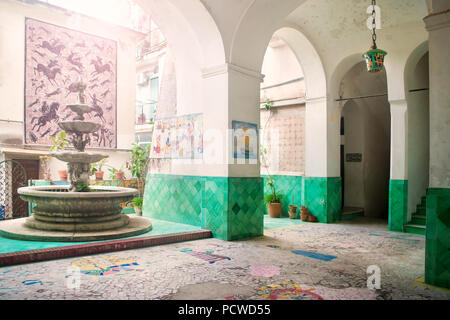inner part of residential building with fountain decorated with ceramics in traditional Italian style in Vietri Sul Mare, Campania, Italy - Stock Photo