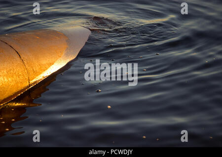 Industrial wastewater discharged into the river. water pollution - Stock Photo