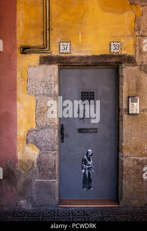 Abstract pastel coloured walls and doorway with graffitti in the Barri Gotic, Gothic quarter, Barcelona, Spain - Stock Photo