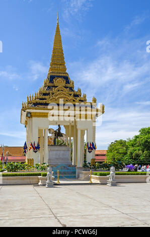 Phnom Penh, Cambodia - April 8, 2018: Statue of King Norodom sits on a white horse to the east of the main building or the vihear of the Silver Pagoda - Stock Photo