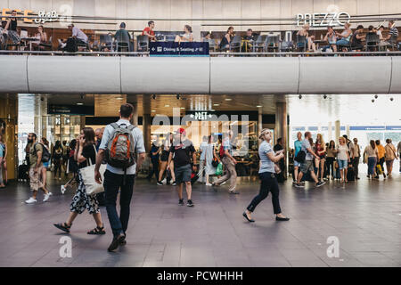 People walking past Pret A Manger cafe inside King's Cross station, one of the largest railway stations in London and a significant transport hub. - Stock Photo
