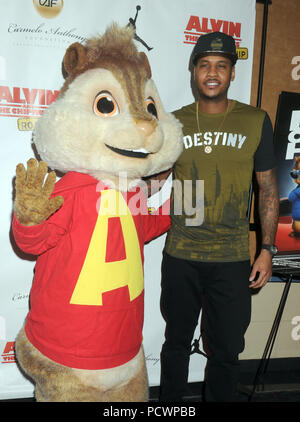NEW YORK, NY - DECEMBER 15: Alvin of Alvin and the Chipmunks and professional basketball player Carmelo Anthony attends 'Alvin and the Chipmunks: The Road Chip' New York screening at Regal E-Walk on December 15, 2015 in New York City.   People:  Alvin, Carmelo Anthony - Stock Photo