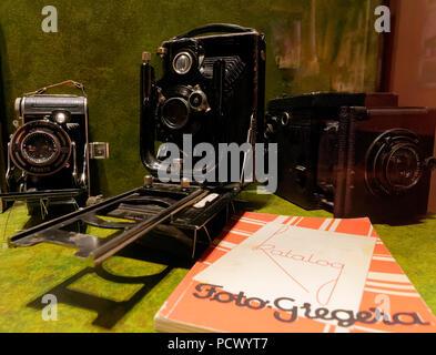 Vintage cameras on display - Stock Photo
