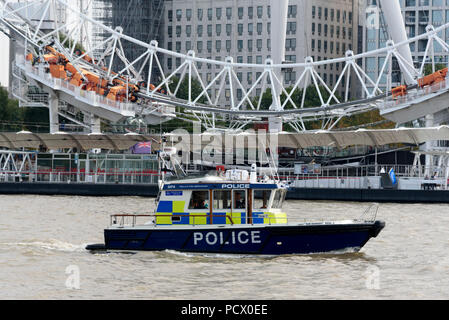 12-10-2017 London, UK. A police boat heading upstream on the River Thames in front of the London Eye Photo: © Simon Grosset - Stock Photo