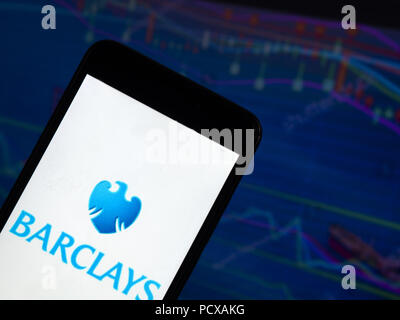 Kiev, Ukraine. 4th Aug, 2018. The Barclays application seen displayed on a smart phone with a background of a stock market. Barclays plc is a British multinational investment bank and financial services company headquartered in London. Credit: Igor Golovniov/SOPA Images/ZUMA Wire/Alamy Live News - Stock Photo