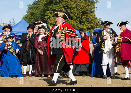 Windsor, UK. 4th August, 2018. David Hinde, Town Crier of Helmsley, wins the 3rd place award at the Ancient and Honourable Guild of Town Criers (AHGTC) National Championship beneath the walls of Windsor Castle. Forty criers from around the UK and two from Australia competed in two rounds of crying, the first a home cry scored on diction, inflection, clarity and volume and the second a cry on the topic of 'A Celebration'. Credit: Mark Kerrison/Alamy Live News - Stock Photo