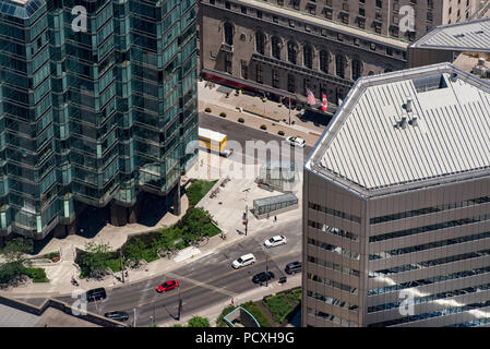 Toronto, Ontario, Canada.  Looking northeast from top of CN Tower in summer at University Avenue in foreground and York Street. - Stock Photo